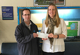 Dustin Parker of Saint-Gobain presents cheque to Southside Public School